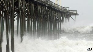 Waves pound Carolina Beach pier in Carolina Beach, N.C., Saturday, Oct 27,