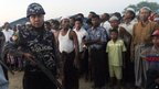 Armed police officer with Muslim refugees at Sittwe camp - 27 October