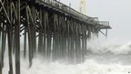 Waves pound Carolina Beace pier, in North Carolina  (27/10/12)
