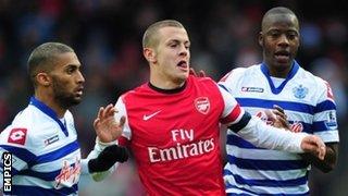Armand Traore (l) and Samba Diakite (r) track Arsenal's Jack Wilshere