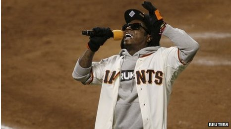 Rapper Lil Wayne sings at a baseball game