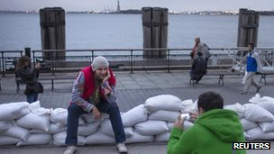 Visitors with the Statue of Liberty in the background, 29 Oct