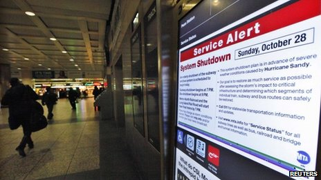 A service announcement explains public transportation closures at Penn Station in New York, 28 October 2012