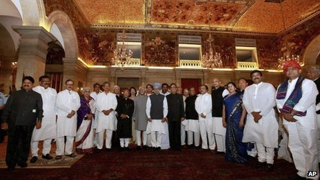 Indian Prime Minister Manmohan Singh, center, in blue turban poses with newly sworn in ministers after the swearing-in ceremony in New Delhi, India, Sunday, Oct. 28, 2012
