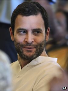 Congress party leader Rahul Gandhi attends the swearing-in ceremony for the new ministers in New Delhi, India, Sunday, Oct. 28, 2012