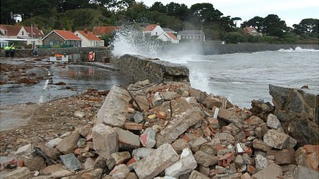 Perelle coast road with rumble used to temporarily fill the gap in the sea wall