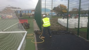 A worker digs up materials at Waterside Farm Leisure Centre