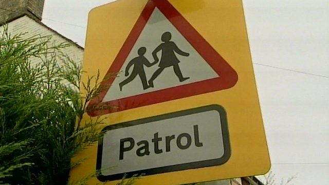 School crossing patrol road sign