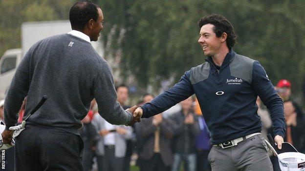 Tiger Woods (left) congratulates Rory McIlroy on his one-stroke victory