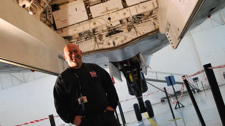 Kevin Stone stood under the bomb bay of the Vulcan Bomber