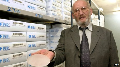 President of PIP Jean-Claude Mas holding a breast implant, January 2001