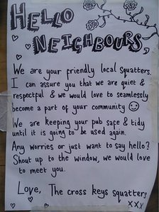 The squatters' sign outside the pub