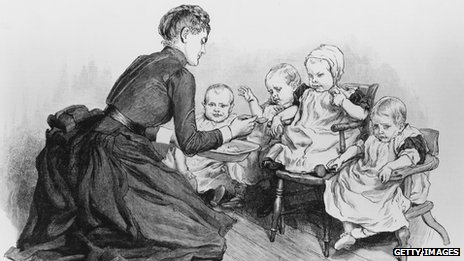 A nurse feeds children in the baby room at a home run by the NSPCC