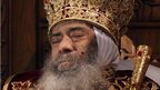 A file image shows the body of Pope Shenouda III, the spiritual leader of the Middle East's largest Christian minority, sitting dressed in formal robes at the St Mark's Coptic Cathedral in Cairo's al-Abbassiya district (file image from 18 March 2012).