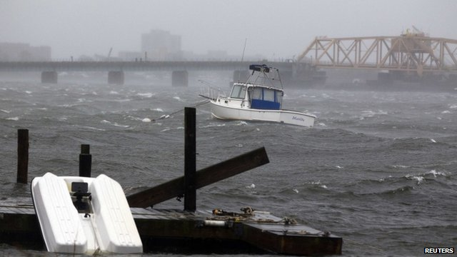 A boat is seen in the rough waters near the Beach Channel section of the Queens borough of New York