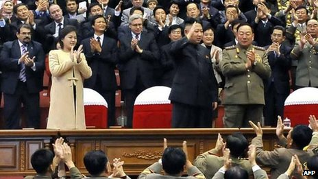 North Korean leader Kim Jong-un (C), with his wife Ri Sol-ju wearing a beige coat, watching a concert in Pyongyang, 29 October 2012