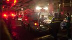 Paramedics move patients into ambulances as they evacuate Tisch hospital in New York