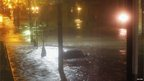 A lone car in a flooded street in Hoboken