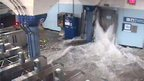 CCTV footage of water flooding the protective doors of a PATH rail station in Hoboken New Jersey