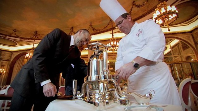 Michel Roux Jr, learns how to prepare one of Escoffier's classic dishes using a meat press at the Ritz