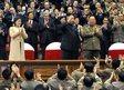 Kim Jong Un, centre, his wife Ri Sol Ju (in beige coat)