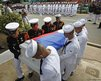 Soldiers carry the coffin of a fellow soldier