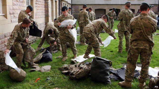 Soldiers from 3rd Battalion The Rifles unpack their kit at Redford Barracks, Edinburgh