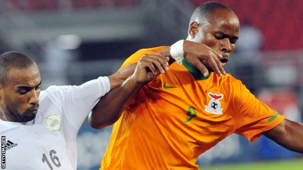 Collins Mbesuma (right)