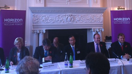 Tatsuro Ishizuka, chief executive of Hitachi's power systems company, flanked by energy executives and UK politicians