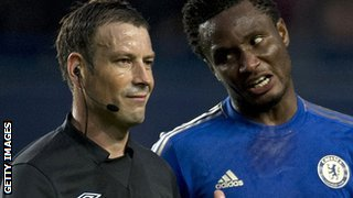 Referee Mark Clattenburg and Mikel John Obi