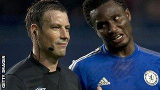 Referee Mark Clattenburg and Mikel John Obi