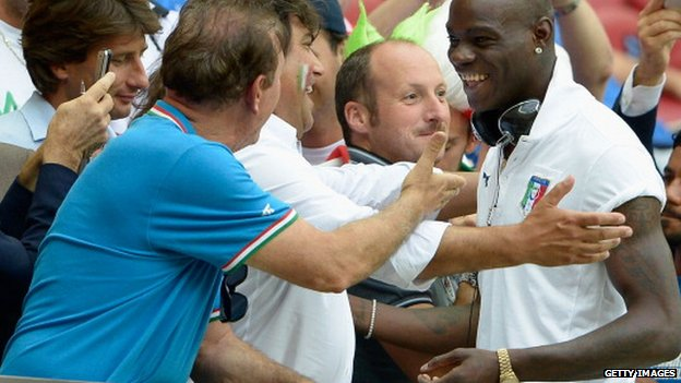 Mario Balotelli of Italy signs autographs for fans ahead of the Uefa Euro 2012 semi final match between Germany and Italy at National Stadium on 28 June 2012 in Warsaw, Poland