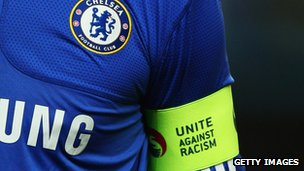 "A Chelsea footballer in a ""Unite Against Racism"" armband - October 2009"