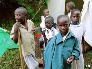 Tutsi children mutilated by machetes during Rwanda's civil war at a Red Cross hospital in Kigali on 12 May 1994