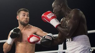 German-born Afghan boxer Hamid Rahimi (left) and Tanzanian Said Mbelwa in the ring