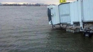 An airport boarding gate in flood waters at LaGuardia Airport, New York