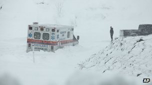 An ambulance is stuck in over a foot of snow off of near Belington, West Virginia on 30 October 2012