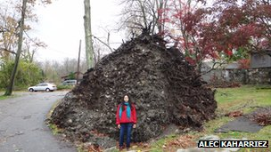 Sara Misenas in front of an uprooted tree in Mohegan Lake, New York