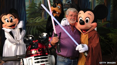 George Lucas poses with Star Wars inspired Disney characters in 2010