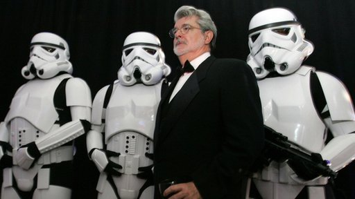 George Lucas posing with Storm Troopers