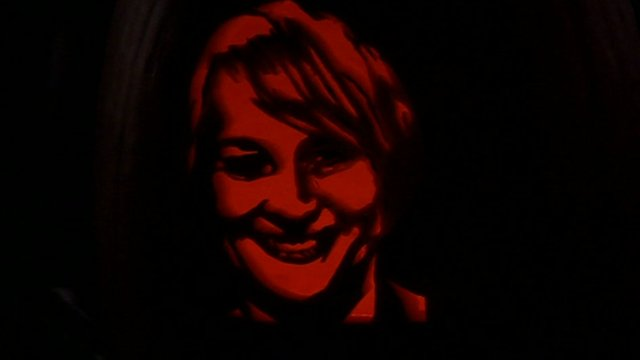 Face of Louise Minchin carved into pumpkin
