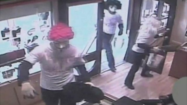 CCTV showing armed raiders inside a jewellery shop in Wigan