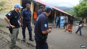 File photo: East Timorese police with members of the UN police