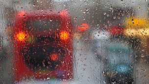 Bus through a rain streaked window