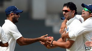 "India ""A"" cricketers Irfan Pathan (L), Suresh Raina (R) and Yuvraj Singh celebrate the wicket of England batsman Kevin Pietersen during the second day of a three day practice match between India ""A"" and England at The Cricket Club of India (CCI) grounds in Mumbai on October 31, 2012"