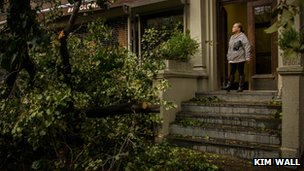 Woman looking at a fallen tree in front of her house, New York City, 30 Oct 2012, Photo: Kim Wall