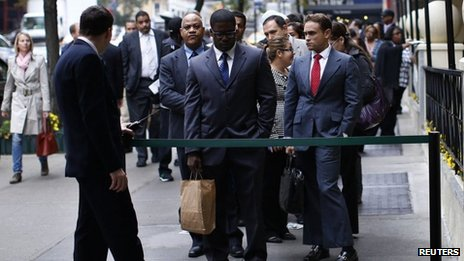 Job seekers line up at a career fair in New York City on 24 October