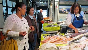 Judite Santos Lima at a fishmonger&#039;s in a Lisbon market