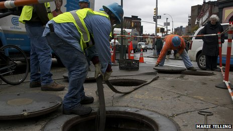 Workers pumping water out of a sewer, New York City, 30 October 2012. Photo: Marie Telling