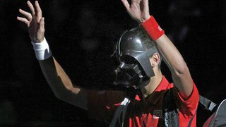 Novak Djokovic arrives on court wearing a Darth Vader mask